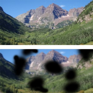 This image shows two different views of the same mountain range.  The top image is a clear view of the Maroon Bells in Colorado.  The bottom image shows blur, and randomly distributed black splotches which represent the visual disturbance caused by diabetic retinopathy.