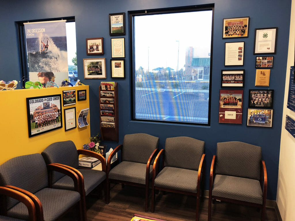 Vista Eye Care supports local sports teams and youth organizations. This image shows our waiting room, tiled with the thank you letters, plaques, and photos of the various teams and groups we have sponsored over the years here in Thornton, Colorado!