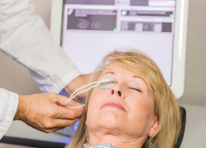 Vista Eye Care is among the only offices in Thornton, Colorado that offer LipiFlow treatments!  This image shows a woman sitting for the procedure.  A applicator eye cup is over the right eye while a technician perform LipiFlow to allow the patient to greatly reduce their dry eye symptoms.