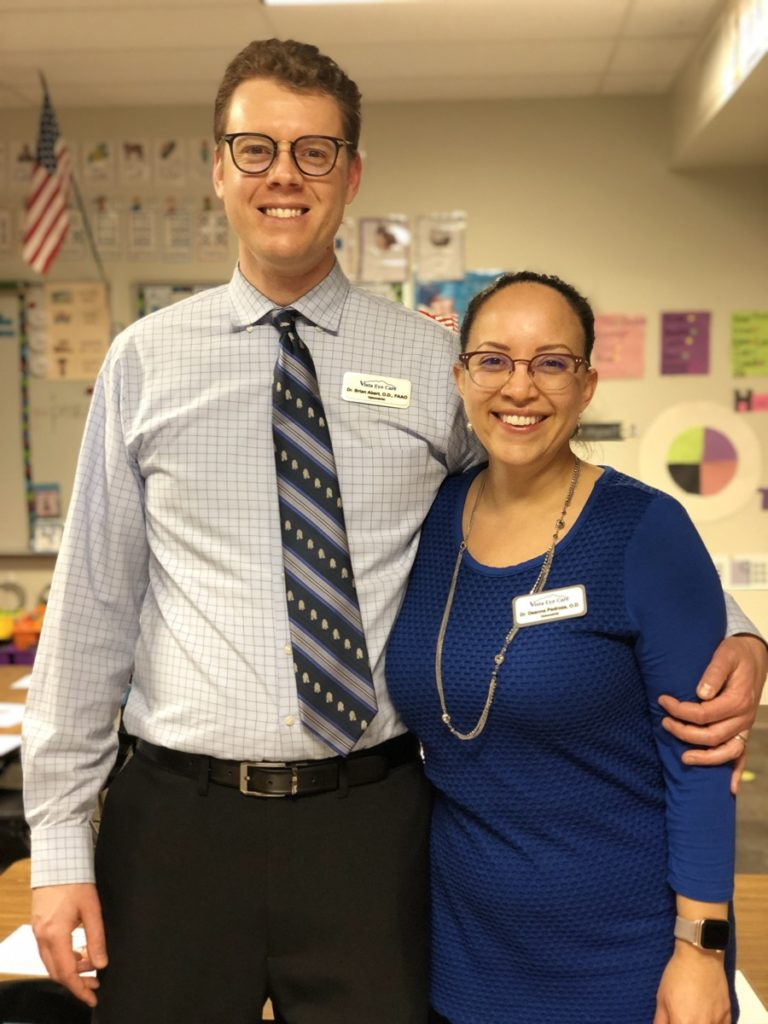 Drs. Abert and Pedroza pose together at a school.