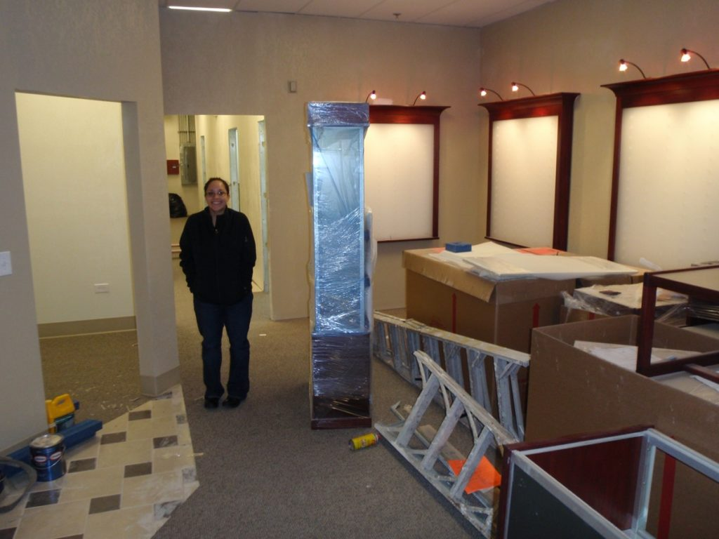 Dr. Pedroza stands in the middle of the office as it slowly takes shape.