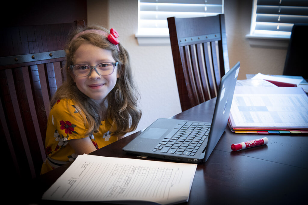 Little girl does first grade on computer